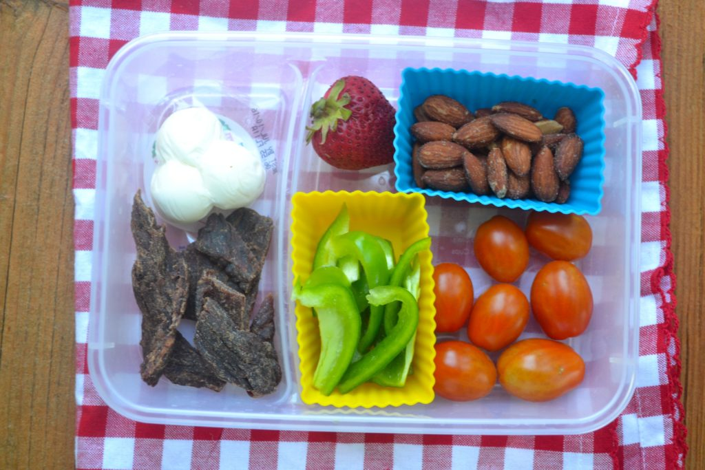 Protein Box Lunches are a delicious, healthy option to add to your weekly meal planning ideas. Cashews, almonds, hard boiled eggs and cheese provide enough protein to keep you full until dinner! Sweet fruit cut into easy to eat pieces and crackers for the cheese make this a complete grab-and-go lunch. The Idea: Thinking of new ideas for weekday.
